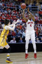 Ohio State guard Sierra Calhoun, right, goes up for a shot against Central Michigan guard Cassie Breen during the first half of a second-round game in the NCAA women's college basketball tournament in Columbus, Ohio, Monday, March 19, 2018. (AP Photo/Paul Vernon)