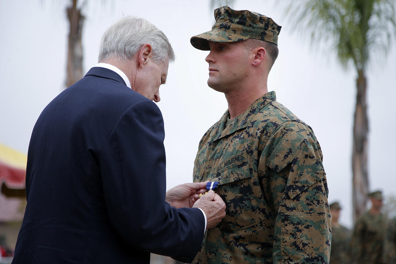 U.S. Marine Sgt. William Soutra Jr., right, receives the Navy Cross from Secretary of the Navy Ray Mabus during a ceremony held at Camp Pendleton, Calif., Monday, Dec. 3, 2012. Soutra was awarded the medal for his heroism while serving in Afghanistan. (AP Photo/Jae C. Hong)