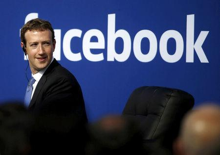 Facebook CEO Mark Zuckerberg is seen on stage during a town hall at Facebook's headquarters in Menlo Park California