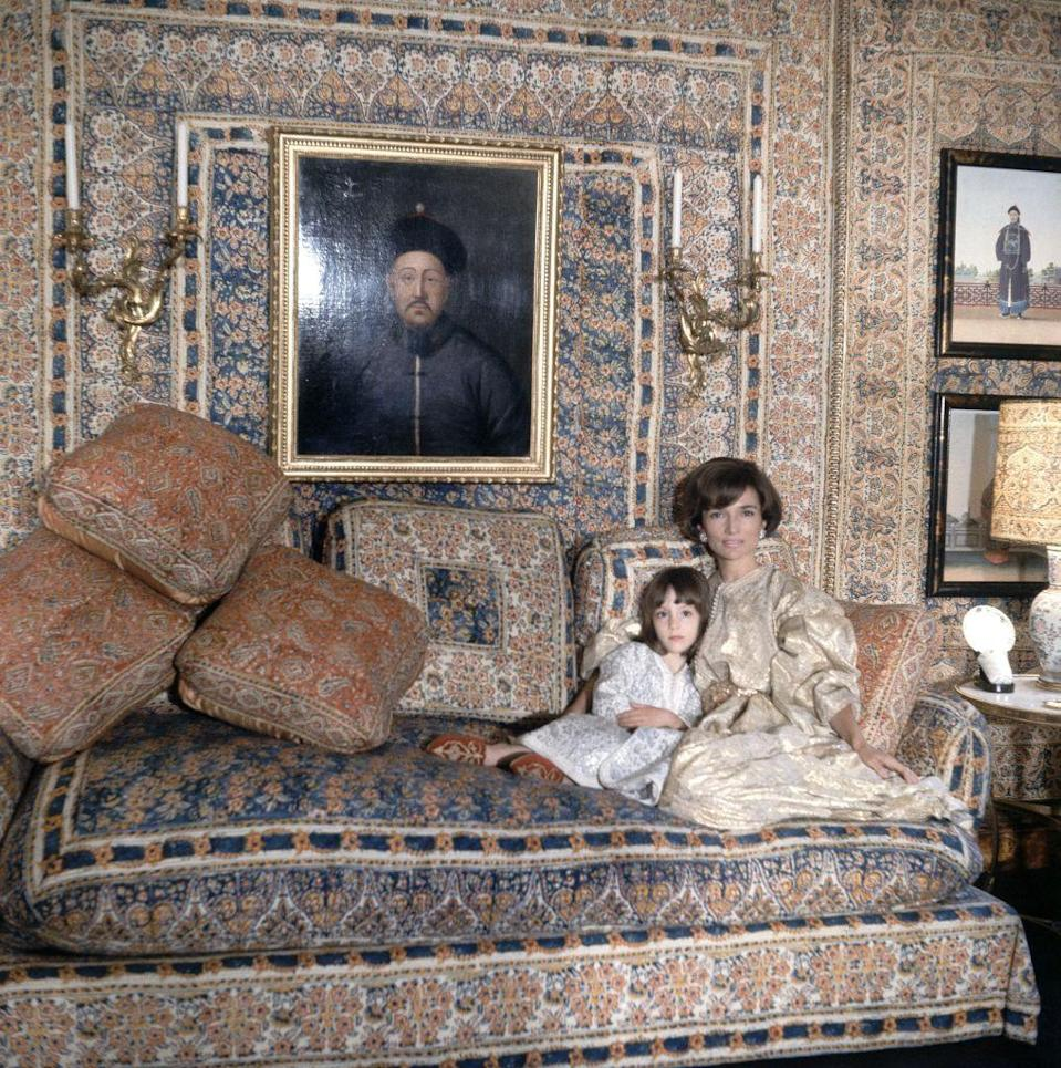 <p>Legendary designer Renzo Mongiardino enveloped the London drawing room of Lee Radziwill, seen here in 1966, with a melée of floral and paisley-printed Indian cottons that were cut apart and pieced together to create the effect of paneling. </p>