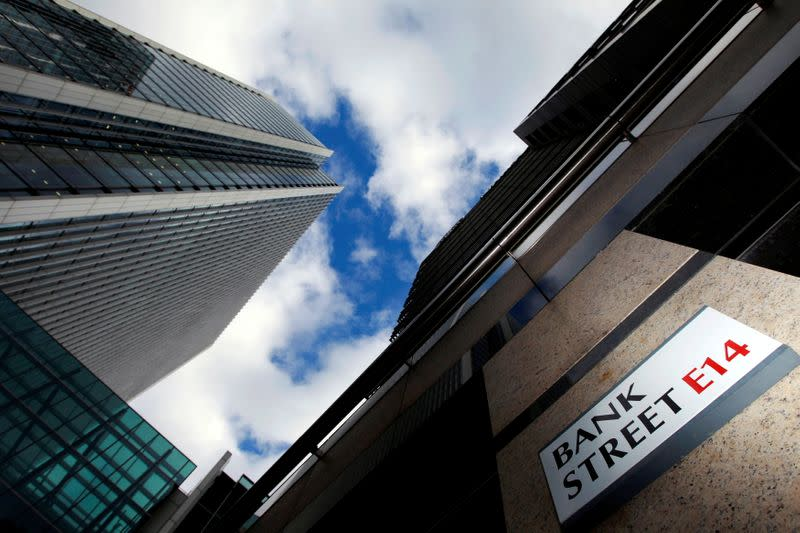 FILE PHOTO: A sign for Bank Street and high rise offices are seen in the financial district in Canary Wharf in London