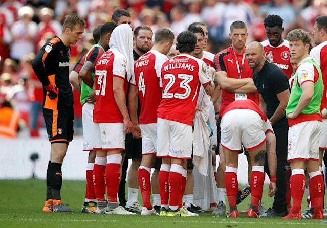 "Soccer Football - League One Play-Off Final - Rotherham United v Shrewsbury Town - Wembley Stadium, London, Britain - May 27, 2018 Rotherham manager Paul Warne speaks to his players during extra time Action Images/Carl Recine EDITORIAL USE ONLY. No use with unauthorized audio, video, data, fixture lists, club/league logos or ""live"" services. Online in-match use limited to 75 images, no video emulation. No use in betting, games or single club/league/player publications. Please contact your account representative for further details."