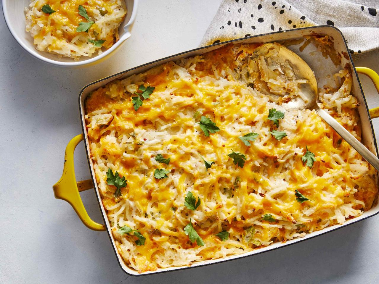 """<p>This Cheesy Potato Bake makes a great potluck dish or side for brunch. It's super easy to mix together and throw in the oven, and you can even assemble it a day ahead and bake just before serving. You can use any brand of shredded hash browns, or make it with fresh potatoes that you peel, boil and dice beforehand. Cream of bacon soup is readily available, even if you've never heard of it.</p> <p><a href=""""https://www.myrecipes.com/recipe/cheesy-potato-bake"""">Cheesy Potato Bake Recipe</a></p>"""