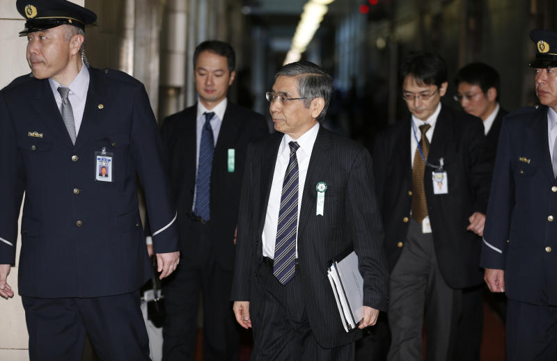 Asian Development Bank President Haruhiko Kuroda, who was recently nominated by Japan's Prime Minister Shinzo Abe to head the country's central bank,  center, arrives at a lower house committee meeting in Tokyo, Monday, March 4, 2013. (AP Photo/Shizuo Kambayashi)