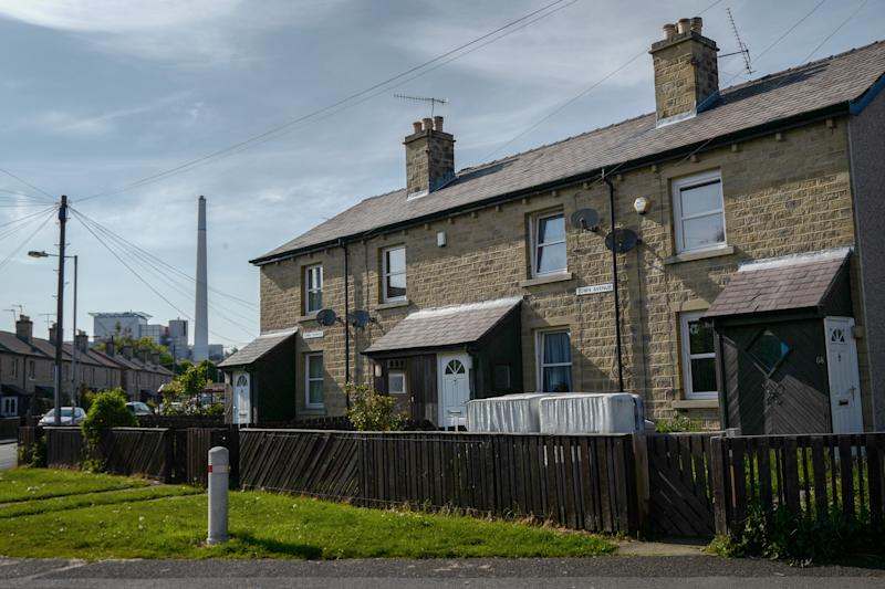 HUDDERSFIELD, ENGLAND - MAY 13: A factory is seen beyond houses on a residential estate close to the John Smith's Stadium ahead of the Brexit Party rally on May 13, 2019 in Huddersfield, England. Nigel Farage, the former leader of the U.K. Independence Party, is campaigning for the Brexit Party's contest for this month's European Parliament elections, whose candidates include Annunziata Rees-Mogg. Despite voting to leave the European Union in 2016 Britain is braced to take part in the European Parliament election on May 23. (Photo by Anthony Devlin/Getty Images)
