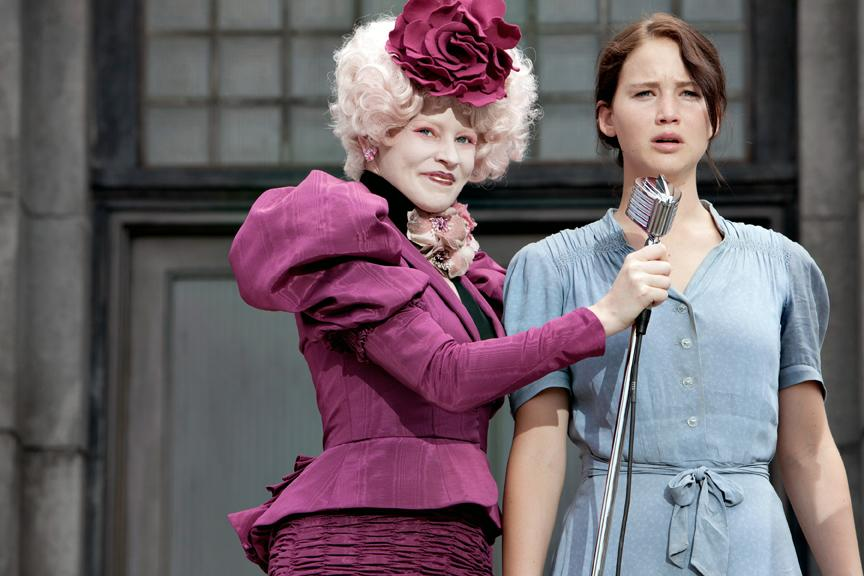 Hunger Games escort and Capitol liason Effie Trinket, ( Elizabeth Banks), and Katniss Everdeen are pictured after Katniss volunteers herself as tribute.
