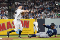 New York Yankees second baseman DJ LeMahieu throws to first to complete a double play after forcing out Seattle Mariners' Abraham Toro (13) during the sixth inning of a baseball game Thursday, Aug. 5, 2021, in New York. Luis Torrens was out at first. (AP Photo/Mary Altaffer)