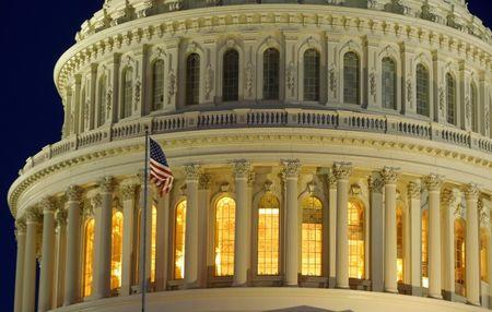 The United States Capitol Dome is seen before dawn in Washington