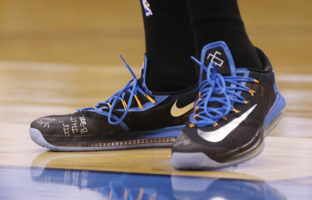 "Oklahoma City Thunder forward Kevin Durant has the phrase ""It's Just B-Ball"" written on his shoes as the Thunder face the Memphis Grizzlies in Game 5 of an opening-round NBA basketball playoff series in Oklahoma City, Tuesday, April 29, 2014. (AP Photo)"