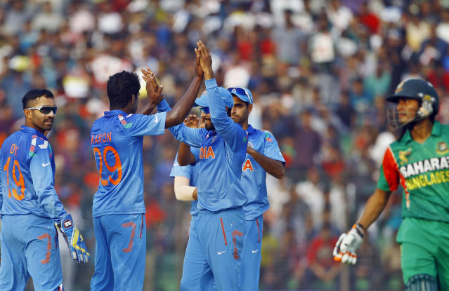 India's Varun Aaron, second left, celebrates with teammates the dismissal of Bangladesh's Anamul Haque during the Asia Cup one-day international cricket tournament in Fatullah, near Dhaka, Bangladesh, Wednesday, Feb. 26, 2014. (AP Photo/A.M. Ahad)