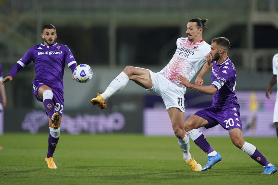 AC Milan's Zlatan Ibrahimovic vies for the ball with Fiorentina's Valentin Eysseric, left, and Fiorentina's German Pezzella, right, during a Serie A soccer match between Fiorentina and AC Milan, in Florence's Artemio Franchi stadium, Italy, Sunday, March 21, 2021. (Spada/LaPresse via AP)