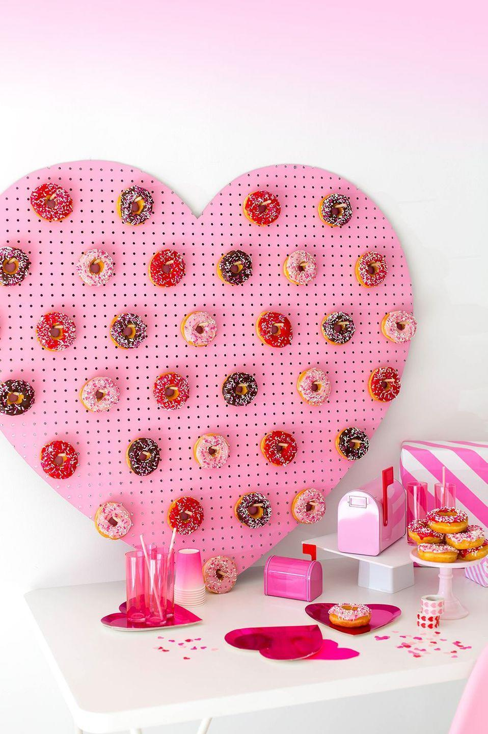 "<p>Make your home a romantic oasis by decking it out with sweet heart-shaped items. We love this donut peg wall — treats + decor = double win! — but there are so many incredible <a href=""https://www.goodhousekeeping.com/holidays/valentines-day-ideas/g30174656/valentines-day-decor-ideas/"" rel=""nofollow noopener"" target=""_blank"" data-ylk=""slk:DIY Valentines' Day decorations"" class=""link rapid-noclick-resp"">DIY Valentines' Day decorations</a> that you can whip up in no time. </p><p><em><a href=""http://www.awwsam.com/2018/02/diy-heart-donut-pegboard.html"" rel=""nofollow noopener"" target=""_blank"" data-ylk=""slk:Get the tutorial at Aww Sam »"" class=""link rapid-noclick-resp"">Get the tutorial at Aww Sam »</a></em></p>"
