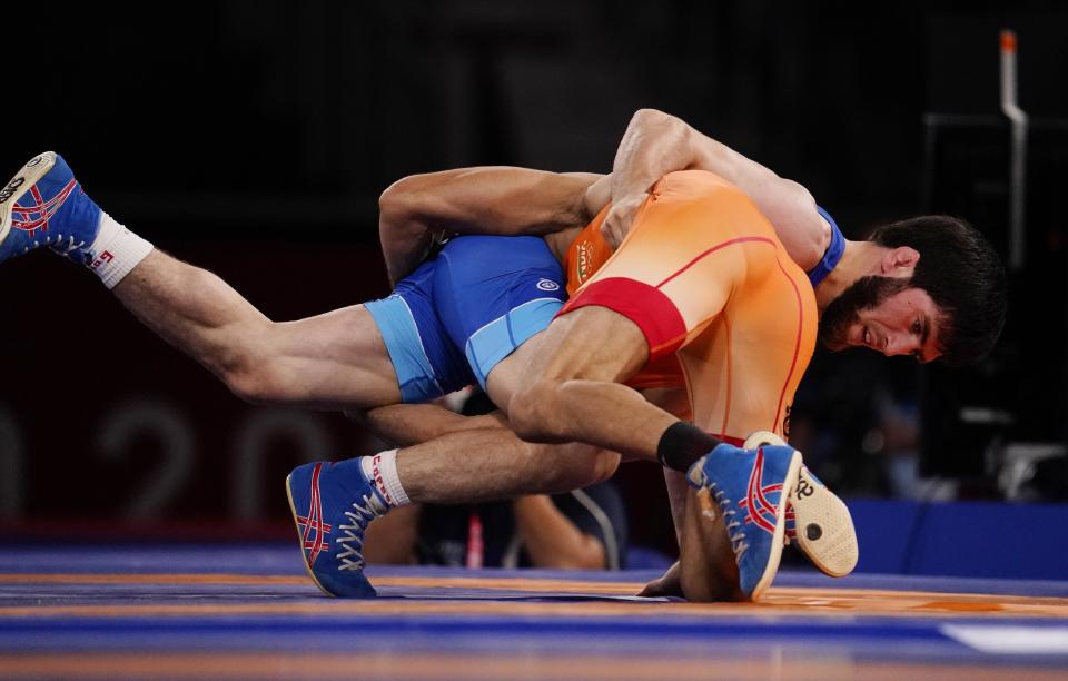 Aug 5, 2021; Chiba, Japan;  Zavur Uguev (ROC) defeats Kumar Ravi (IND) in the men's freestyle 57kg final during the Tokyo 2020 Olympic Summer Games at Makuhari Messe Hall A. Mandatory Credit: Mandi Wright-USA TODAY Sports