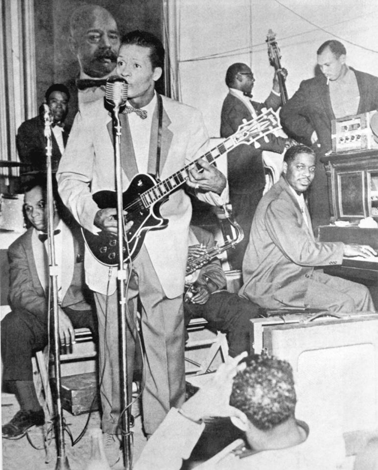 <p>Rock and roll musician Chuck Berry plays a Gibson Les Paul electric guitar as he performs onstage with his band including piano player Johnnie Johnson in circa 1957. (Photo by Michael Ochs Archives/Getty Images) </p>