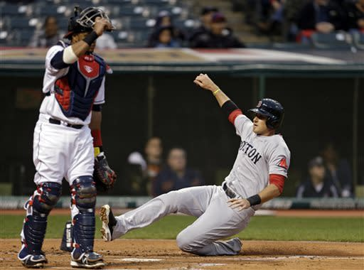 Boston Red Sox's Will Middlebrooks slides home to score against the Cleveland Indians on a sacrifice fly by Pedro Ciriaco in the second inning of a baseball game, Tuesday, April 16, 2013, in Cleveland. (AP Photo/Mark Duncan)