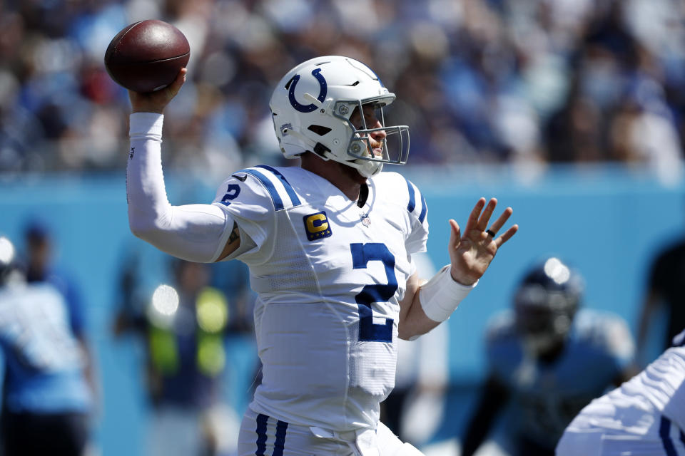 Indianapolis Colts quarterback Carson Wentz passes against the Tennessee Titans in the first half of an NFL football game Sunday, Sept. 26, 2021, in Nashville, Tenn. (AP Photo/Wade Payne)