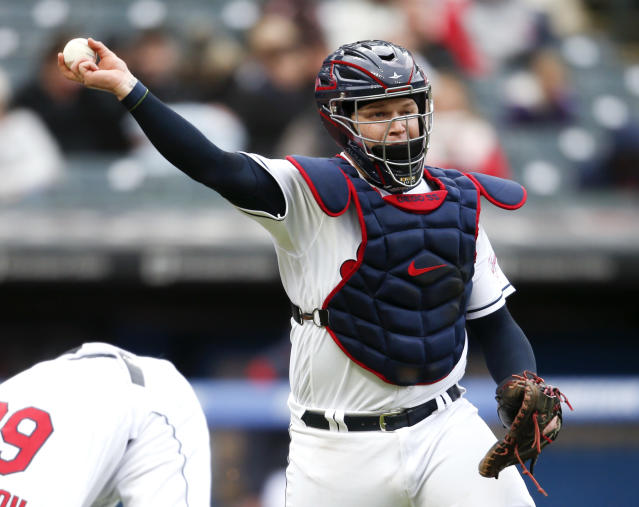 Cleveland Indians' Roberto Perez throws out Chicago White Sox's Ryan Cordell at first base during the third inning of a baseball game, Tuesday, May 7, 2019, in Cleveland. (AP Photo/Ron Schwane)