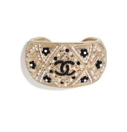 """<p><a class=""""link rapid-noclick-resp"""" href=""""https://go.redirectingat.com?id=127X1599956&url=https%3A%2F%2Fwww.chanel.com%2Fen_GB%2Ffashion%2Fp%2Fcjy%2Fab5968b05325%2Fab5968b05325nb907%2Fcuff-metal-cultured-fresh-water-pearls-glass-pearls-resin-gold-pearly-white-black.html&sref=https%3A%2F%2Fwww.harpersbazaar.com%2Fuk%2Ffashion%2Fjewellery-watches%2Fg35190301%2Fsex-and-the-citys-best-jewellery-moments%2F"""" rel=""""nofollow noopener"""" target=""""_blank"""" data-ylk=""""slk:SHOP NOW"""">SHOP NOW</a></p><p>Metal, pearl and glass cuff, £1,340, <a href=""""https://go.redirectingat.com?id=127X1599956&url=https%3A%2F%2Fwww.chanel.com%2Fen_GB%2Ffashion.html&sref=https%3A%2F%2Fwww.harpersbazaar.com%2Fuk%2Ffashion%2Fjewellery-watches%2Fg35190301%2Fsex-and-the-citys-best-jewellery-moments%2F"""" rel=""""nofollow noopener"""" target=""""_blank"""" data-ylk=""""slk:Chanel"""" class=""""link rapid-noclick-resp"""">Chanel</a></p>"""