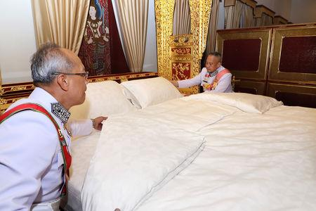 Royal officials make the bed of Thailand's King Maha Vajiralongkorn during the ceremony of Assumption of the Royal Residence inside the Grand Palace in Bangkok, Thailand, May 4, 2019. The Committee on Public Relations of the Coronation of King Rama X via REUTERS