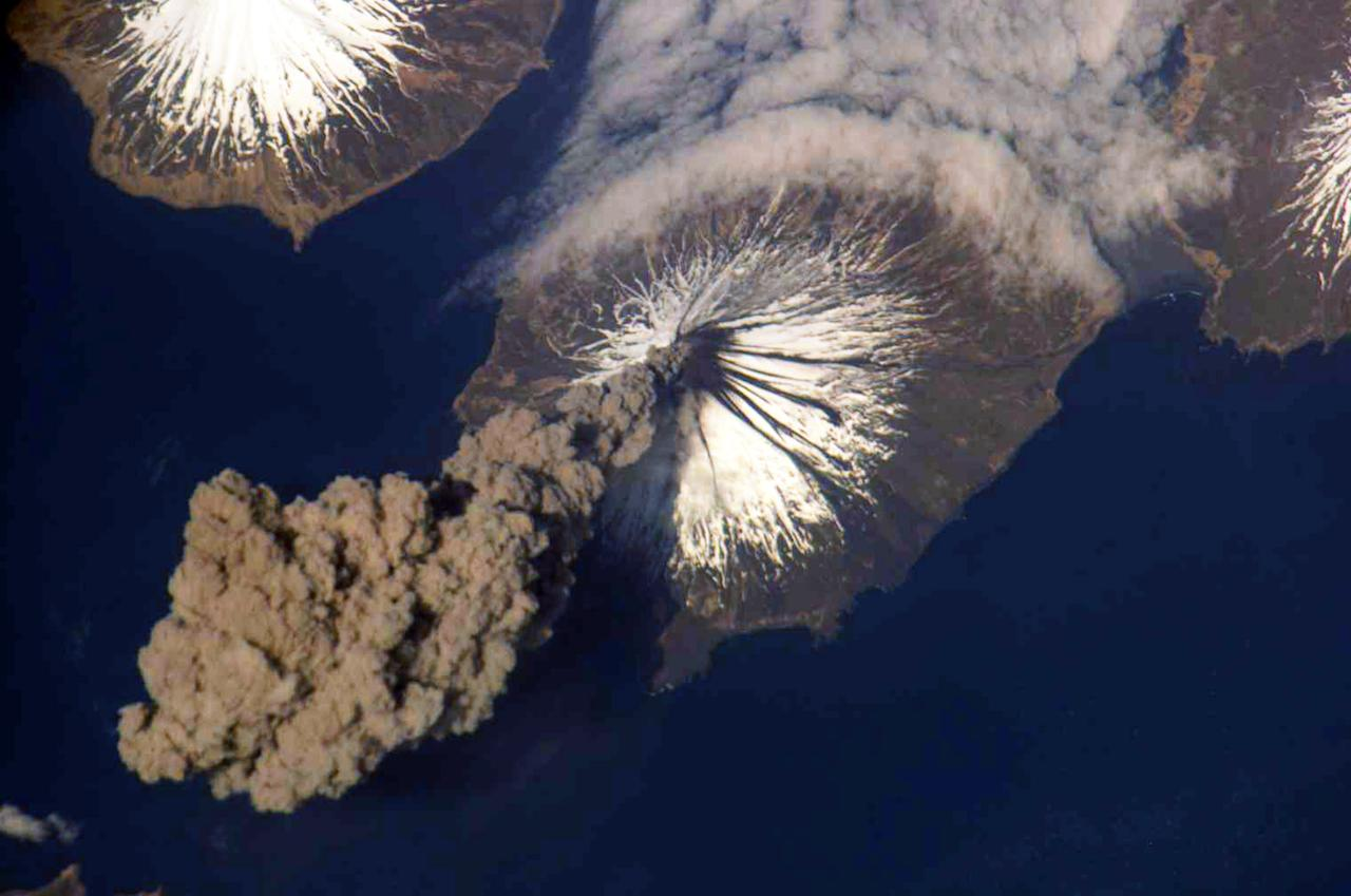 ALASKA - MAY 23:  (FILE PHOTO) In this photo provided by NASA, The eruption of the Cleveland Volcano is seen as photographed by an Expedition 13 crewmember on the International Space Station May 23, 2009 in the Aleutian Islands, Alaska. The Cleveland Volcano has erupted again yesterday sending a cloud of ash 15,000 feet into the sky according to reports on December 30, 2011. (Photo by NASA via Getty Images)
