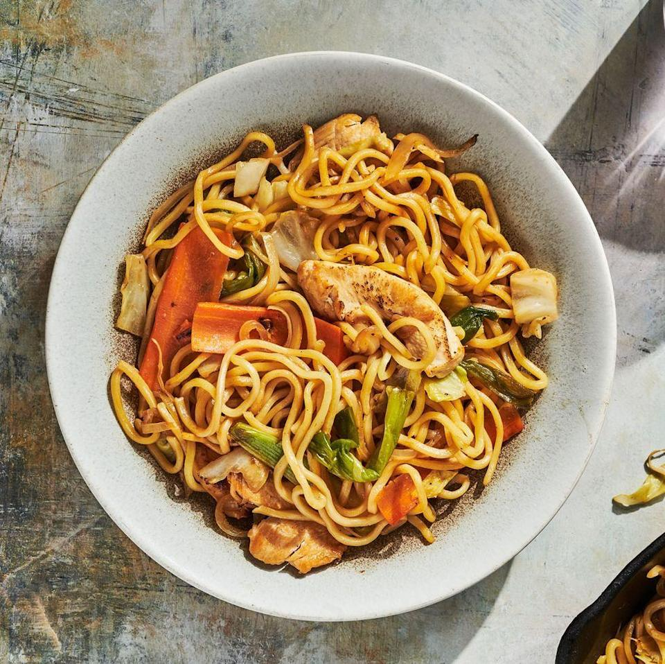 """<p>The key to a good yakisoba is the noodles and the sauce. You can often find refrigerated yakisoba noodles in the supermarket in a small plastic pack but if you can't find them, you can go for something like spaghetti or even well drained ramen in a pinch. As for the sauce, you can find awesome store bought versions (it often even comes in the yakisoba noodle packages).</p><p>Get the <a href=""""https://www.delish.com/uk/cooking/recipes/a35819009/chicken-yakisoba-recipe/"""" rel=""""nofollow noopener"""" target=""""_blank"""" data-ylk=""""slk:Chicken Yakisoba"""" class=""""link rapid-noclick-resp"""">Chicken Yakisoba</a> recipe.</p>"""
