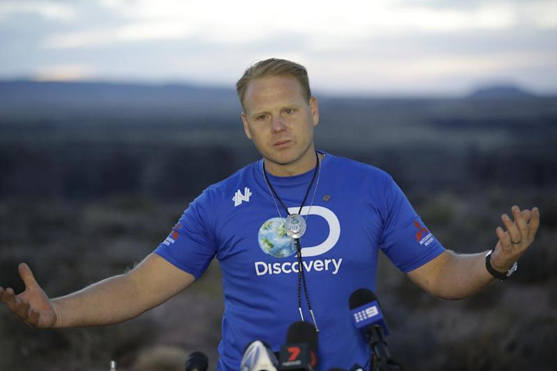 Daredevil Nik Wallenda smiles during a news conference after crossing a tightrope 1,500 feet above the Little Colorado River Gorge Sunday, June 23, 2013, on the Navajo reservation outside the boundaries of Grand Canyon National Park. Wallenda completed the tightrope walk that took him a quarter mile across the gorge in just more than 22 minutes. (AP Photo/Rick Bowmer)