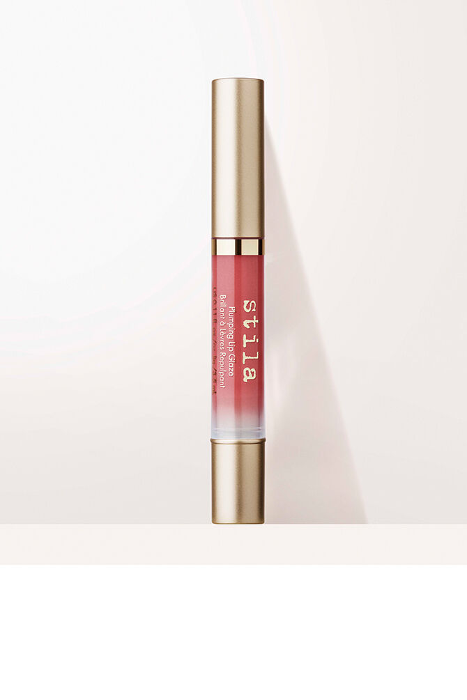 "<h2>Stila Plumping Lip Glaze</h2><br><a href=""https://www.refinery29.com/en-us/2020/09/10015792/stila-plumping-lip-glaze-review"" rel=""nofollow noopener"" target=""_blank"" data-ylk=""slk:Cult-beauty classic, Stila, re-debuted its nostalgia-inducing Lip Glaze"" class=""link rapid-noclick-resp"">Cult-beauty classic, Stila, re-debuted its nostalgia-inducing Lip Glaze</a> this past month — and after our beauty writer, Karina Hoshikawa, penned her ode to it, readers rushed to cart. Featuring a fully reformulated gloss with all the shine and none of the stickiness, <a href=""https://fave.co/32lNYHC"" rel=""nofollow noopener"" target=""_blank"" data-ylk=""slk:Lip Glaze"" class=""link rapid-noclick-resp"">Lip Glaze</a> is, dare I say, back and better than ever. Unlike many glosses both then and now, Stila's is crafted with a retro twist-up, brush-tip applicator — which has always reminded me of painting my lips à la the ""Honor To Us All"" scene in <em>Mulan</em> where Mulan is getting a pre-matchmaker appointment makeover. The tube feels almost identical to the original (except reimagined in a matte gold sheen) but has gotten another 2020 update: hydrating and plumping benefits,"" she sang.<br><br><em>Shop <strong><a href=""https://www.stilacosmetics.com/plumping-lip-glaze/SC54.html"" rel=""nofollow noopener"" target=""_blank"" data-ylk=""slk:Stila"" class=""link rapid-noclick-resp"">Stila</a></strong></em><br><br><strong>Stila</strong> Plumping Lip Glaze, $, available at <a href=""https://go.skimresources.com/?id=30283X879131&url=https%3A%2F%2Fwww.stilacosmetics.com%2Fplumping-lip-glaze%2FSC54.html%3F"" rel=""nofollow noopener"" target=""_blank"" data-ylk=""slk:Stila"" class=""link rapid-noclick-resp"">Stila</a>"