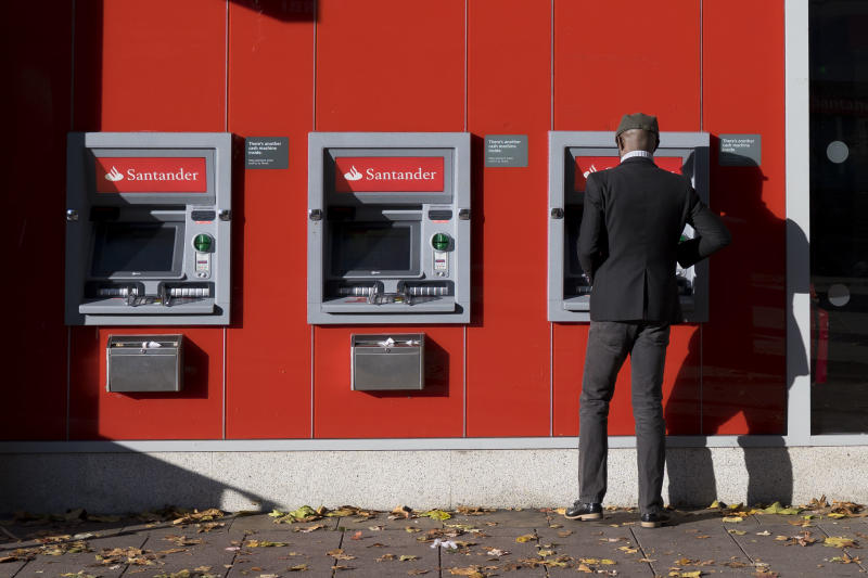 CARDIFF, UNITED KINGDOM - OCTOBER 28: A man uses a Santander cashpoint on October 28, 2018 in Cardiff, United Kingdom. (Photo by Matthew Horwood/Getty Images)