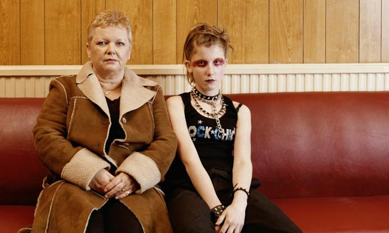 Mature woman with teenage girl (14-16) dressed as punk, portrait