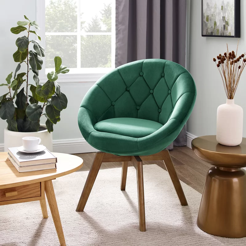 """<h3>Carson Carrington Tufted Swivel Chair</h3><br><strong>Best For: Small Spaces</strong><br>This bright and modern swivel chair is perfect for small offices spaces and reading nooks. It features a circular seat that's wrapped in tufted soft velvet and comes in an array of jewel-toned shades. <br><br><strong>The Hype: </strong>4.4 out of 5 stars and 146 reviews on <a href=""""https://www.overstock.com/Home-Garden/Carson-Carrington-Kallax-Velvet-Tufted-Round-Swivel-Accent-Chair/30537659/product.html"""" rel=""""nofollow noopener"""" target=""""_blank"""" data-ylk=""""slk:Overstock"""" class=""""link rapid-noclick-resp"""">Overstock</a><br><br><strong>Comfy Butts Say:</strong> """"I love this chair. Very easy to put together. It's a great little accent chair and perfect for this small space. The color is a beautiful vibrant yellow.""""<br><br><strong>Carson Carrington</strong> Tufted Round Swivel Chair, $, available at <a href=""""https://go.skimresources.com/?id=30283X879131&url=https%3A%2F%2Fwww.overstock.com%2FHome-Garden%2FCarson-Carrington-Kallax-Velvet-Tufted-Round-Swivel-Accent-Chair%2F30537659%2Fproduct.html"""" rel=""""nofollow noopener"""" target=""""_blank"""" data-ylk=""""slk:Overstock"""" class=""""link rapid-noclick-resp"""">Overstock</a>"""