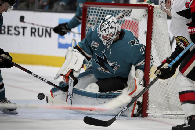 San Jose Sharks goaltender Martin Jones (31) blocks an Ottawa Senators shot during the second period of an NHL hockey game in San Jose, Calif., Saturday, Jan. 12, 2019. (AP Photo/Scot Tucker)