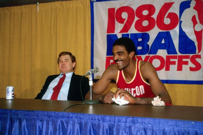 Houston Rockets star Ralph Sampson and coach Bill Fitch talk to reporters during a 1986 NBA playoff series against the Lakers at the Forum.