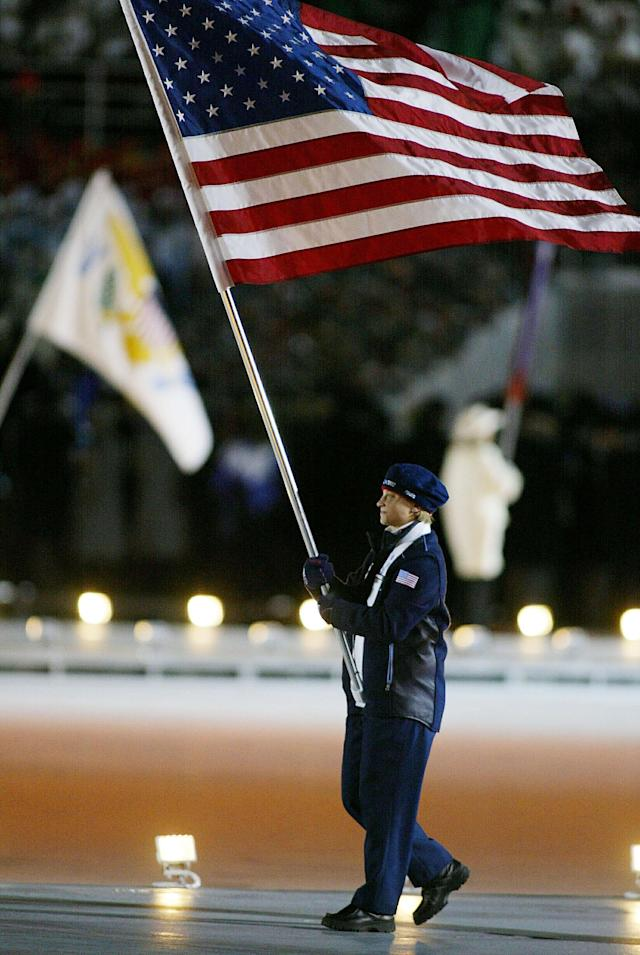 400804 14: (NEWSWEEK, US NEWS, MACLEANS AND GERMANY OUT) Amy Peterson, a short track speed skater from the U.S. Olympic team, carries the U.S. flag during the Opening Ceremony of the 2002 Salt Lake City Winter Olympic Games at the Rice-Eccles Olympic Stadium February 8, 2002 in Salt Lake City, UT. (Photo by Clive Mason/Getty Images)