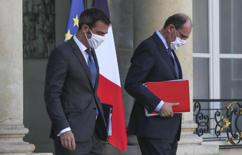 French Health Minister Olivier Veran, left, and French Prime Minister Jean Castex leave the Elysee Palace after the weekly cabinet meeting in Paris, Wednesday, Nov. 4, 2020. Coronavirus cases hit new daily highs in Europe and increasing hospitalizations.. (AP Photo Michel Euler)