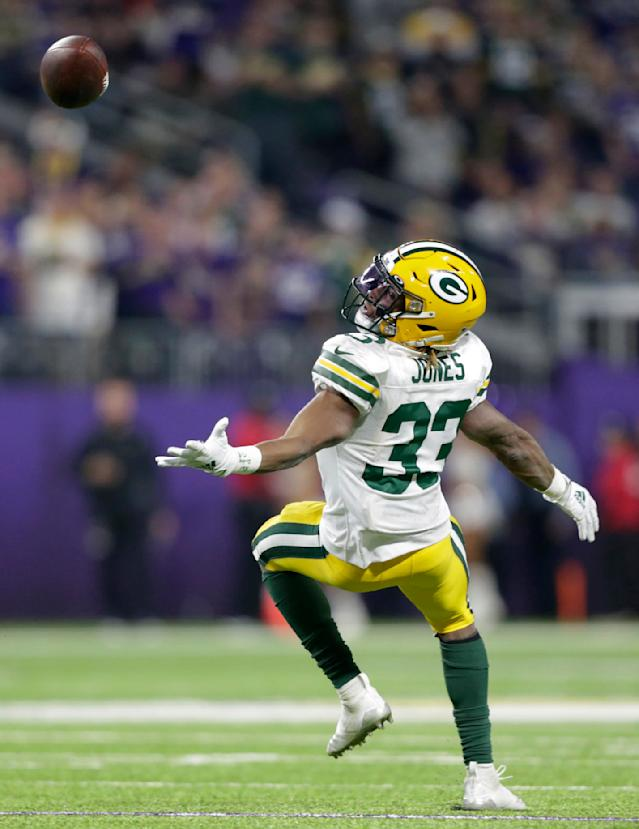 Green Bay Packers running back Aaron Jones tries to make a reception during the first half of the team's NFL football game against the Minnesota Vikings, Monday, Dec. 23, 2019, in Minneapolis. The pass was incomplete. (AP Photo/Andy Clayton-King)