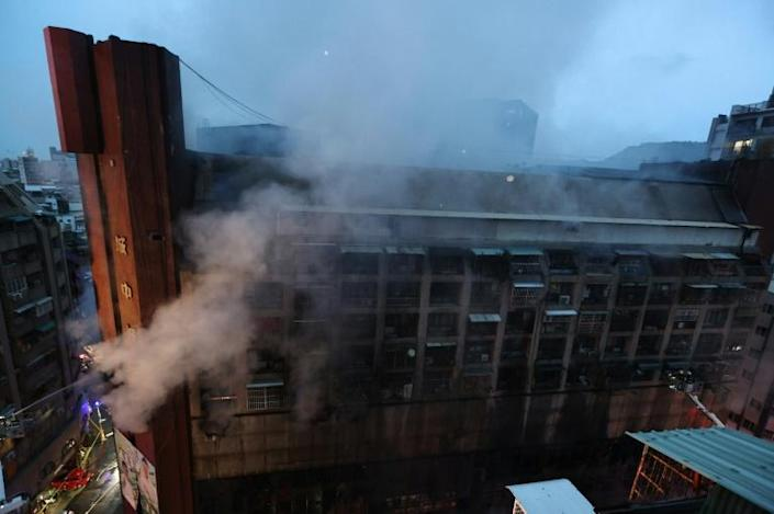 The blaze broke out in the 13-storey, mixed-use building in the southern Taiwanese city of Kaohsiung (AFP/Johnson Liu)