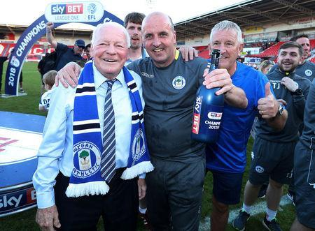 Soccer Football - League One - Doncaster Rovers vs Wigan Athletic - Keepmoat Stadium, Doncaster, Britain - May 5, 2018 Wigan Athletic owner Dave Whelan and manager Paul Cook celebrate after winning League One Action Images/John Clifton