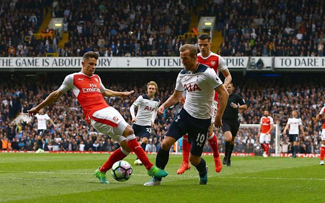 <span>Harry Kane is clipped by Gabriel</span> <span>Credit: Rex Features </span>