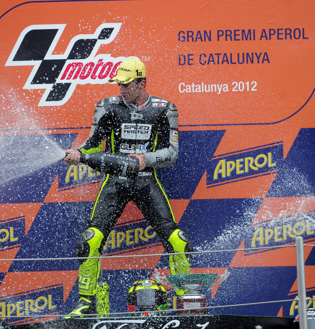 Speed Master's Italian Andrea Iannone celebrates on the podium after winning the Moto2 race of the Catalunya Moto GP Grand Prix at the Catalunya racetrack in Montmelo, near Barcelona, on June 3, 2012. Speed Master's Italian Andrea Iannone won the race ahead of Interwetten-Paddock's Swiss Thomas Luthi and Team CatalunyaCaixa Repsol 's Spanish Marc Marquez. AFP PHOTO / JOSEP LAGOJOSEP LAGO/AFP/GettyImages