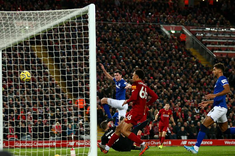 LIVERPOOL, ENGLAND - DECEMBER 04: Michael Keane of Everton Scores a goal to make it 2-1 during the Premier League match between Liverpool FC and Everton FC at Anfield on December 4, 2019 in Liverpool, United Kingdom. (Photo by Robbie Jay Barratt - AMA/Getty Images)