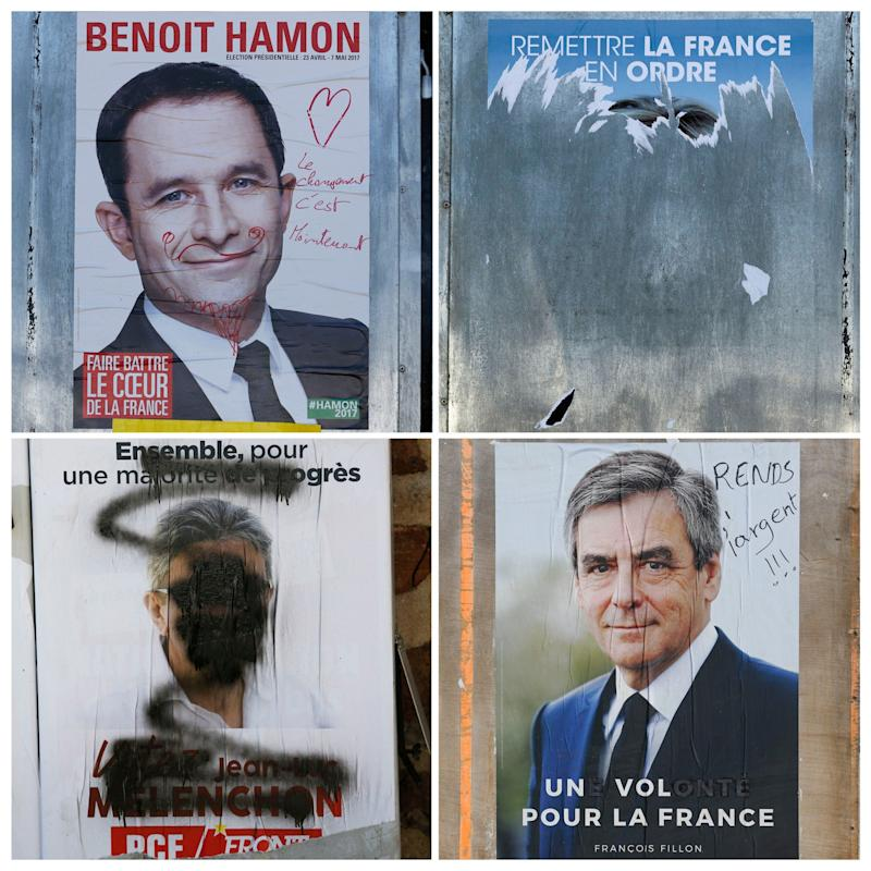The posters of Presidential Candidates Francois Fillon, Marine Le Pen, Benoit Hamon and Jean Luc Melenchon on the eve of the first round of the French presidential election, in Tulle - Credit:  REGIS DUVIGNAU/ REUTERS