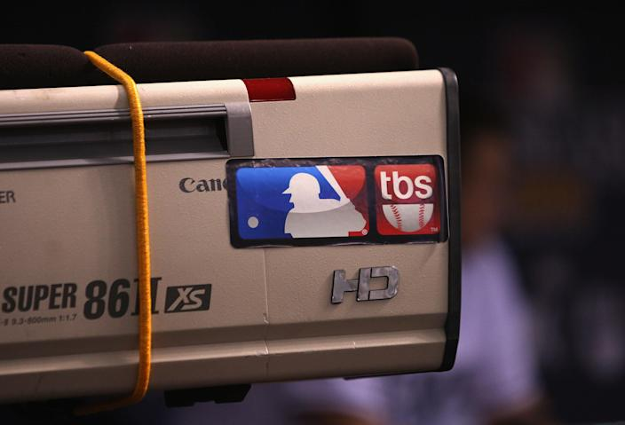 A sticker with the MLB logo and the TBS logo side by side.