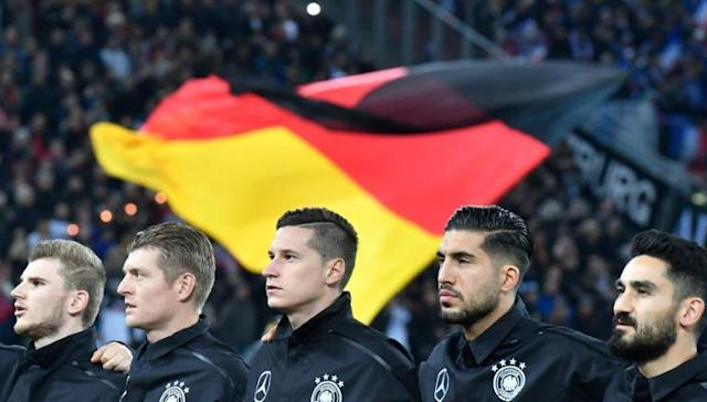 "German FA boss Oliver Bierhoff says Emre Can (second from right) and Ilkay Gundogan (right) ""made a mistake"" by 'liking' a controversial Instagram post. (AFP Photo/John MACDOUGALL)"