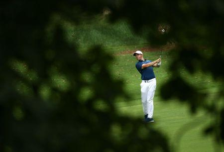 Aug 13, 2017; Charlotte, NC, USA; Rory McIlroy plays from the fairway on the 12th hole of do during the final round of the PGA Championship at Quail Hollow Club. Mandatory Credit: Rob Schumacher-USA TODAY Sports