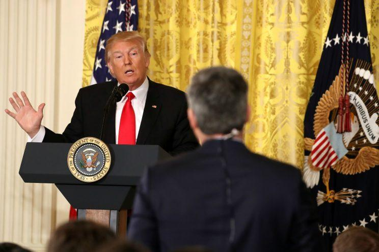 Trump answers a question from CNN's Jim Acosta during a news conference in the East Room at the White House on Thursday. (Mark Wilson/Getty Images)