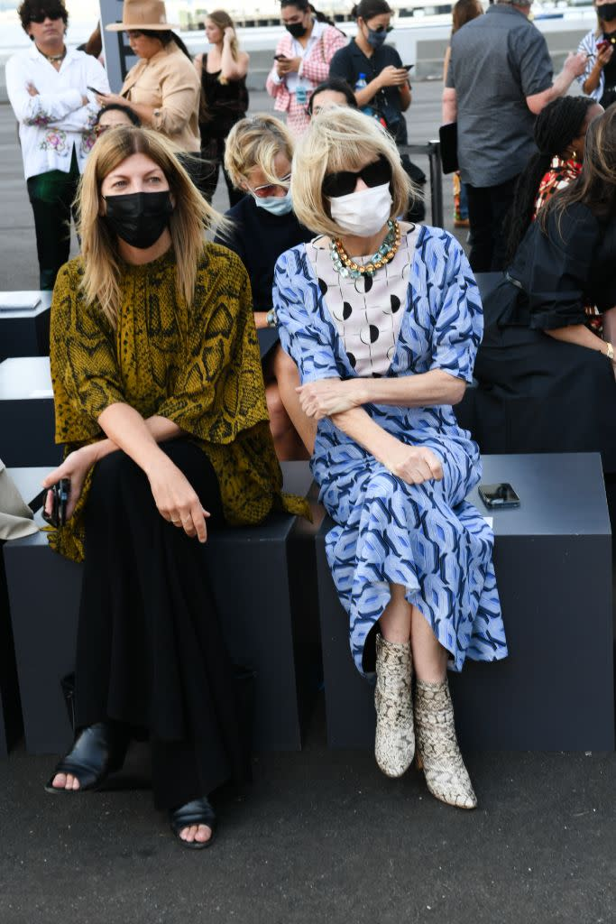 Vogue's Virginia Smith and Anna Wintour masked up at the Coach spring '22 show. - Credit: Courtesy of Coach