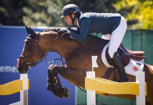 Canada's Ben Asselin rode two clear rounds in 41.92 seconds in Sunday's jump-off round to win the Lafarge Cup at Spruce Meadows in Calgary. (Jeff McIntosh/The Canadian Press - image credit)