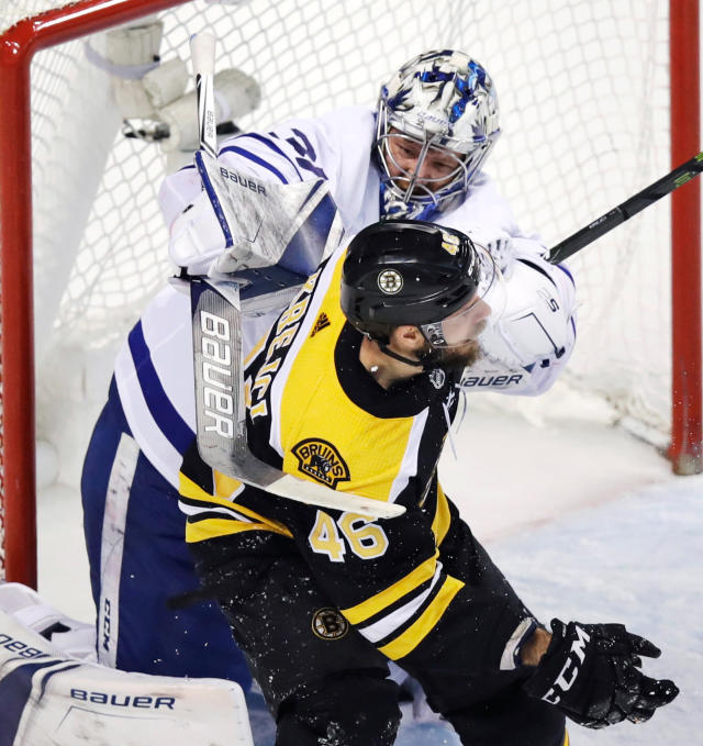 Toronto Maple Leafs goaltender Frederik Andersen, rear, hits Boston Bruins center David Krejci (46) with his stick during the second period of Game 7 of an NHL hockey first-round playoff series in Boston, Wednesday, April 25, 2018. (AP Photo/Charles Krupa)