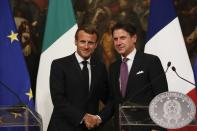 FILE - In this Wednesday, Sept. 18, 2019 file photo, French President Emmanuel Macron and Italian Premier Giuseppe Conte pose as they meet the media at Chigi Palace Premier office in Rome. When Giuseppe Conte exited the premier's office, palace employees warmly applauded in him appreciation. But that's hardly likely to be Conte's last hurrah in politics. Just a few hours after the handover-ceremony to transfer power to Mario Draghi, the former European Central Bank chief now tasked with leading Italy in the pandemic, Conte dashed off a thank-you note to citizens that sounded more like an ''arrivederci″ (see you again) then a retreat from the political world he was unexpectedly propelled into in 2018.(AP Photo/Domenico Stinellis, File)