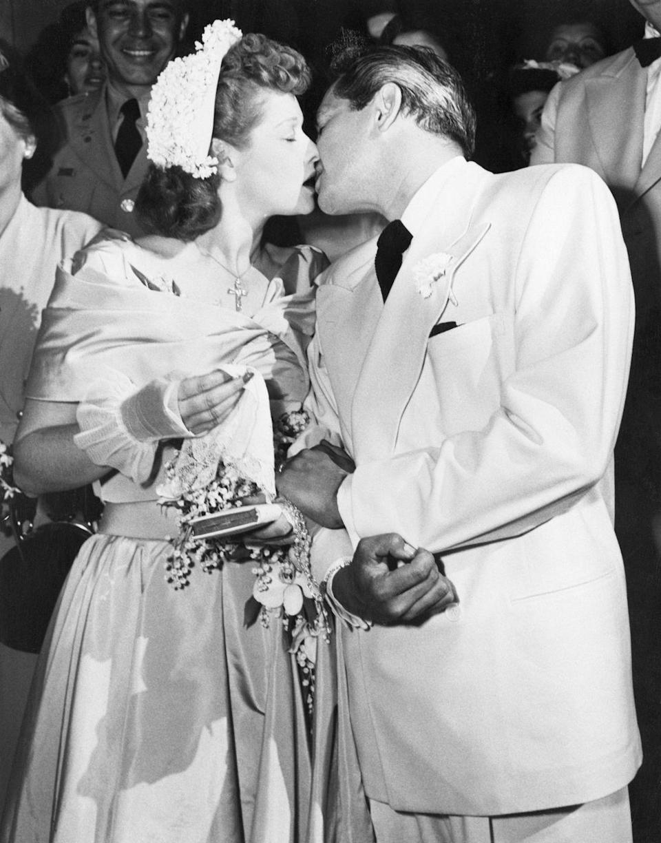 <p>The comedic pair share a kiss after their (second) wedding ceremony in 1949. The two initially married in 1940, but Ball filed for divorce in 1944. The couple reconciled, but a hit show and sky-high ratings didn't keep the duo in paradise forever. They divorced in 1960. She went on to marry comedian Gary Morton in 1961, while he wed Edith Mack Hirsch in 1963.</p>